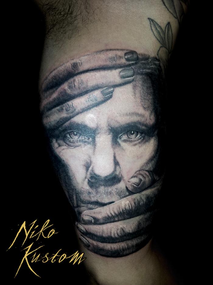 Exclus tattoo